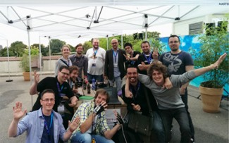 The Dutch VR Meetup at Gamescom 2014 with an early prototype glove.